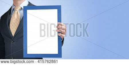 Mockup. Business Man Holding In Hands Empty Blank Photo Frame. Banner With Businessman Holding In Ha