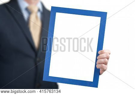 Mockup Image. Businessman Holds The Empty White Board. Man Wearing Business Shirt Holding Blank Pict
