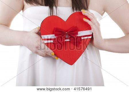 Heart Shape In A Girl Heands Isolated On White