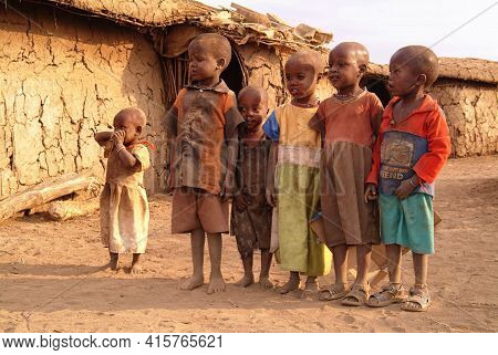 Masai Mara, Kenya - Aug 23, 2010: Little Children From Masai Tribe Dressed With Simple And Dirty Clo