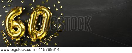 Gold Foil Balloon Number Sixty. Birthday Or Anniversary Card With The Inscription 60. Black Concrete