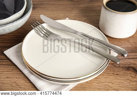 Set Of Clean Dishware On Wooden Table