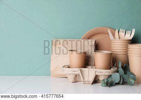 Set Of Disposable Eco Friendly Dishware On White Table. Space For Text