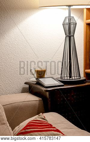 Corner Of A Lounge With Coffee And An E-reader. Concept Of Peace Of Mind At Home, Reading At Home, H