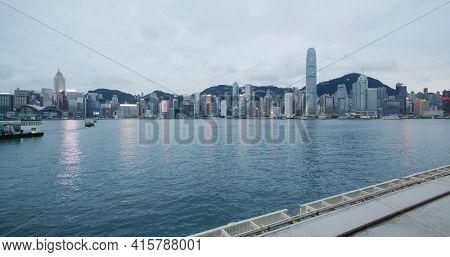 Victoria Harbor, Hong Kong 10 February 2021: Hong Kong city at evening time