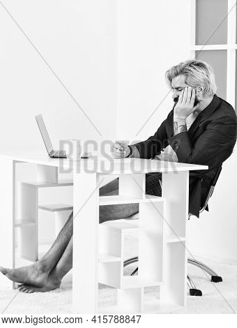 Internet Earnings. Making Notes. Teleworking Man In Home Office. Mature Businessman In Jacket Is Usi