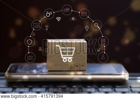 Paper Boxes On Smartphone. Shopping Online / E-commerce E-commerce Or Electronic Commerce Is A Trans