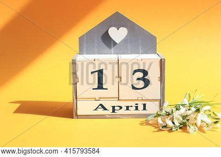 Calendar For April 13: Cubes With The Numbers 0 And 13, The Name Of The Month Of April In English, A