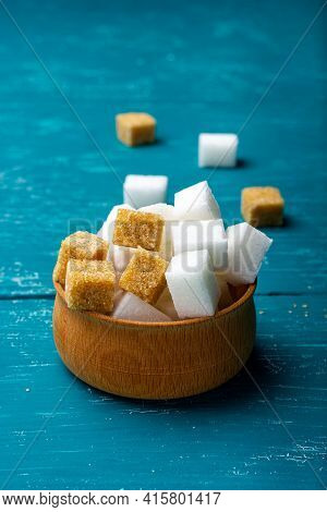Cubes Of Sweet Sugar In A Small Wooden Plate. A Few Grams Of Sugar. Cane Sugar Cubes