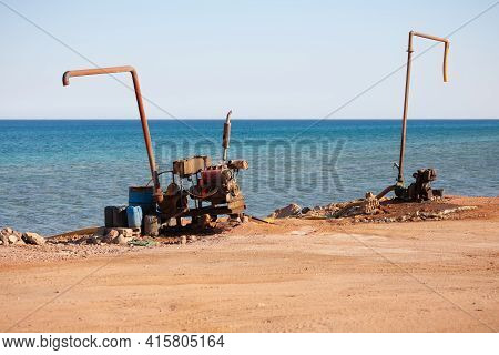 On The Shore There Are Two Pump Pumps For Pumping Sea Water On The Coast Of The Red Sea.