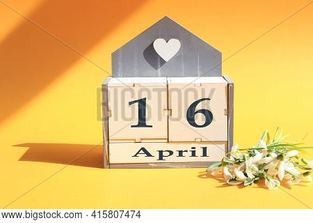 Calendar For April 16: Cubes With The Numbers 0 And 16, The Name Of The Month Of April In English, A