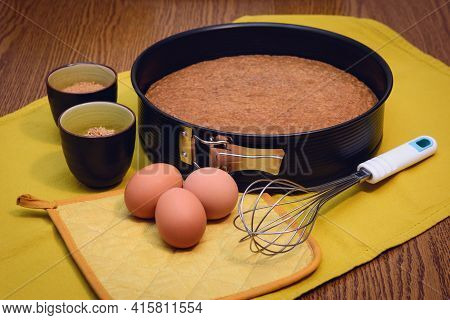 Whisk And Baking Pan With Homemade Traditional Hazelnut Cake From Piedmont (italy) And Raw Ingredien