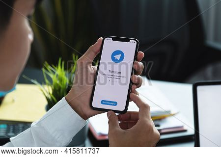 Chiang Mai, Thailand, Apr 06, 2021 : Woman Hand Holding Iphone X With Social Networking Service Tele