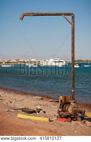 Egypt, The Coast Of The Red Sea - The City Of Dahab. On The Shore There Is A Pump For Pumping Sea Wa