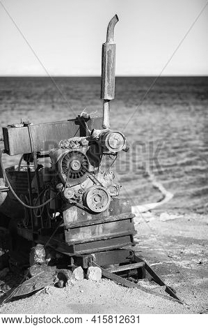 Egypt, Red Sea Coast. On The Shore There Is An Engine For A Pump, Pumping Sea Water To Land