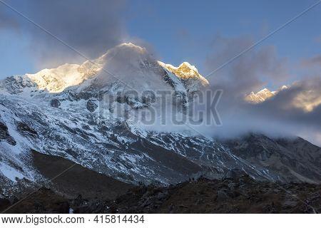First Sunbeams Lighting The Peak Of Mount Annapurna South, Himalaya, Nepal, Annapurna Conservation A