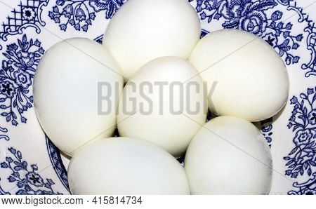 Boiled Eggs Peeled On A Plate Background.whole Peeled Boiled Eggs Top View.