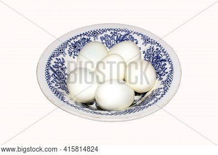 Boiled Eggs, Peeled From The Shell On A Plate On A White Background.whole Peeled Boiled Eggs On A Pl