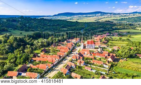 Cloaster, Romania. Transylvania Village And Fortified Church Saxon Landmark In Eastern Europe.