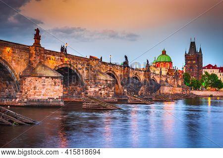 Prague, Czech Republic. The Famous Charles Bridge Sunset And Stare Mesto, Bohemia Travel Place In Eu