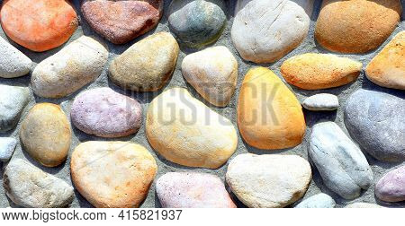 Solid Rocks On River Shoreline In Nature Outdoors.