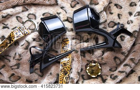 Flat Lay Collage With Woman's Black High-heeled Shoes And Accessories On Leopard Fur Background. Fem