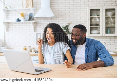 Hilarious Happy Family Making Long-awaited Purchase Online, Buy Using Laptop While Sitting At Home,