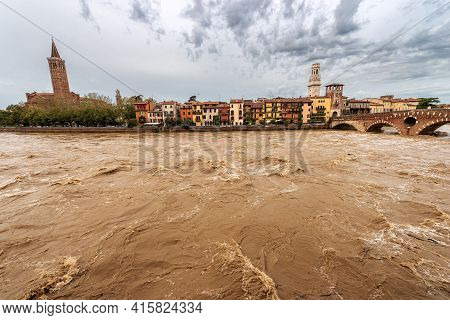 The River Adige In Flood In Verona Downtown After Several Violent Storms. Church Of Santa Anastasia,