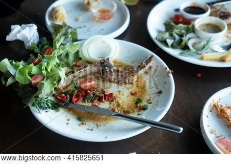 Scrap Of Food In The White Plate After Eating Spicy Steak