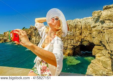 Woman Takes Selfie With Boca Do Inferno Cliff Formation, Cascais, Atlantic Ocean, Portugal. Girl Tak