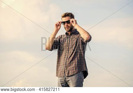 Man Eyewear Model Outdoors Blue Sky Background. Perfect Vision. Fashionista. Handsome Guy Wear Sungl