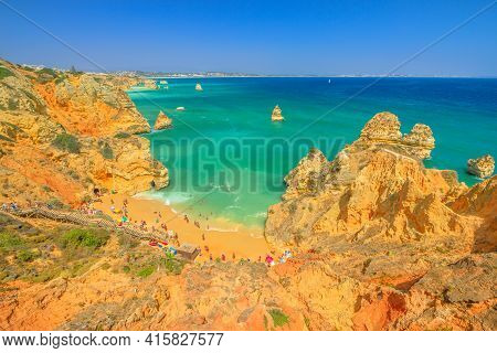 Aerial View Of Praia Do Camilo With Long Steps And Lagos Coastline In Algarve, Portugal, Europe. Tur