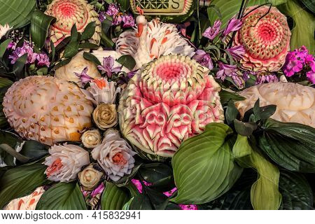 Culinary Carving From Vegetables And Fruits. Beautiful Pink Flower Cut From A Watermelon On A Backgr