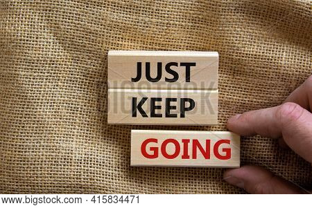 Just Keep Going Symbol. Wooden Blocks With Words 'just Keep Going'. Beautiful Canvas Background, Bus