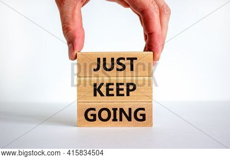 Just Keep Going Symbol. Wooden Blocks With Words 'just Keep Going'. Beautiful White Background, Busi