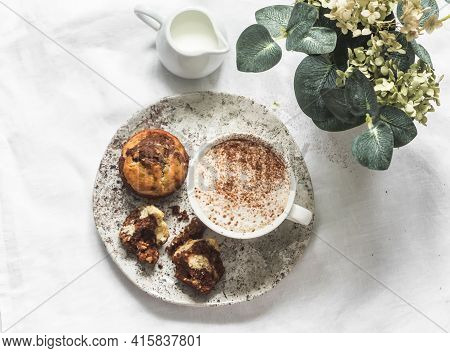 Chocolate Paste, Peanuts, Banana Cakes And Cappuccino On A Light Background, Top View. Delicious Des