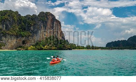Family Kayaking In Sea, Mother And Daughter Paddling In Kayak On Tropical Sea Canoe Tour Near Island