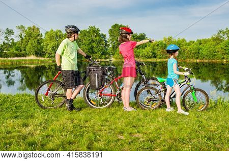 Family Bike Ride Outdoors, Active Parents And Kid Cycling And Relaxing Outdoors Near Beautiful River