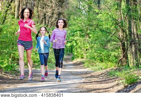 Family Running, Happy Active Mother And Kids Jogging Outdoors, Run With Children In Forest, Healthy