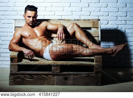 Handsome Man Or Muscular Guy With Sexy, Muscle Torso, Naked Body, With Six Packs Underpants On Woode