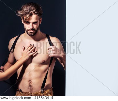 Guy Sexy Young Man With Suspenders On Pants With Female Hand On Bare Muscular Torso