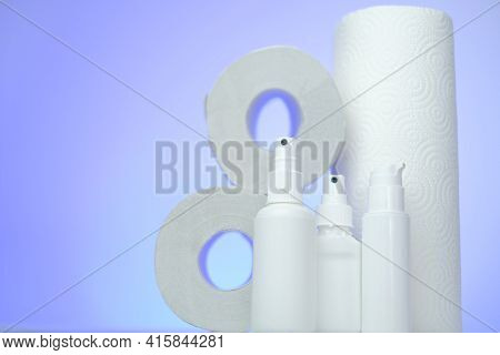 Hygiene And Sanitation . Toilet Paper, Napkins And Antibacterial In White Bottles On A Blurred Backg