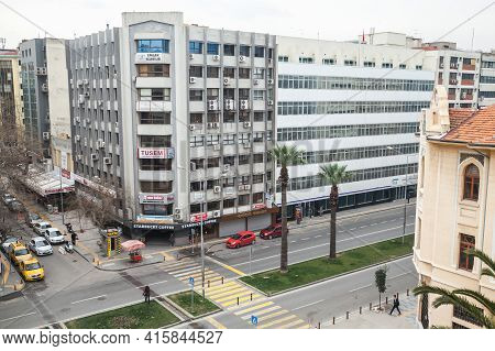 Izmir, Turkey - February 8, 2015: Cumhuriyet Blv, Street View With Cars And Walking People. Central