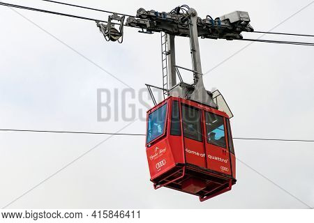 Red Funicular Or Red Suspension Cable Car To Lomnicky Peak In Fog Or Clouds, September 2020, High Ta