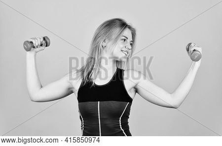 Dedicated To Fitness. Sporty Woman In Sportswear Holding Dumbbells. Sport Fitness Equipment. Fitness