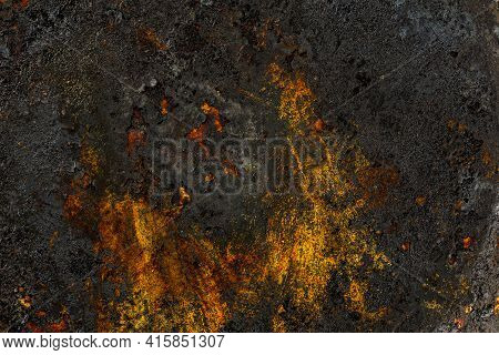 Bottom Side Of A Cast Iron Pan With Thicl Layer Of Soot On It.