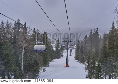 Beautiful Winter Mountain Landscape Of The Urals Region, Russia. Chairlift On The Mount Belaya Or Wh