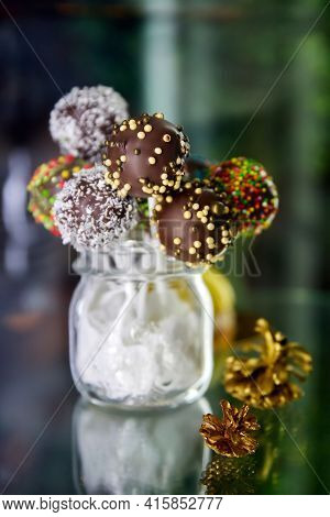 Variety Of Colorful Chocolate Cake Pops In A Transparent Jar. Close-up, Selective Focus
