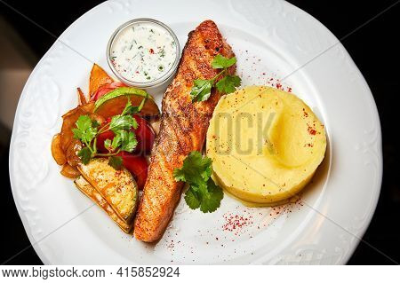 Salmon Steak With Baked Vegetables, Mashed Potatoes And Sauce