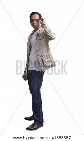 Young Man Holding A Book And Standing On White Background